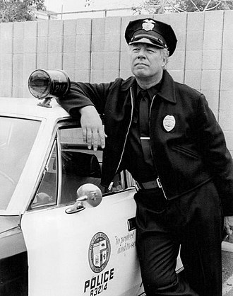 George Kennedy - Kennedy as Bumper Morgan in The Blue Knight, 1976