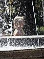 Girl by Fountain - Bendery - Transnistria (36032564083).jpg