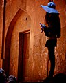 Girl in a blue hat holding a water bottle in India - 2013 (11551989134).jpg
