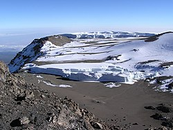 Furtwängler Glacier atop Kilimanjaro in the foreground and snowfields and the Northern Icefields beyond.