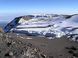Furtwängler Glacier (foreground) as it appeared in August 2003. Behind the glacier are snowfields and the Northern Icefield