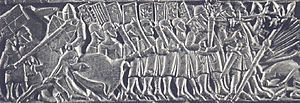 Goedendag - The troops in the center of the column are using the goedendag. Pikemen are on either end. Depiction from the Courtrai Chest.