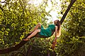 Gorgeous girl with violin lie on the tree branch (Unsplash).jpg