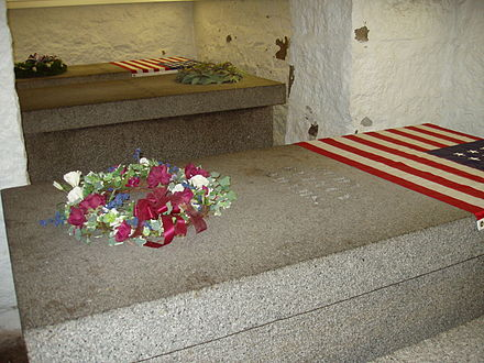 Tombs of Presidents John Adams (far left) and John Quincy Adams (right) and their wives Abigail and Louisa, in a family crypt beneath the United First Parish Church Graves of the Adams, Quincy, Massachusetts.JPG