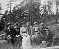 Group of men and women sitting outdoors, May 30, 1898 (WASTATE 2519).jpeg