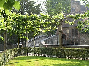 Bruges (Belgium): garden of the Gruuthusemuseum and St Boniface bridge in the morning light