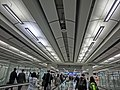 HK International Airport Arrival area zone Moving sidewalk Visitors n ceiling lighting Feb-2013 YF.JPG
