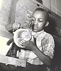 Harlem Community Art Center- student in metal craft class, 290 Lenox Avenue, Manhattan (NYPL b13668355-482613).jpg