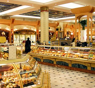 The retail servicescape includes the appearance, equipment, display space, retail counters, signage, layout and functionality of a retail outlet. Pictured:Harrods food court Harrods Food Department Halls (8473364801).jpg