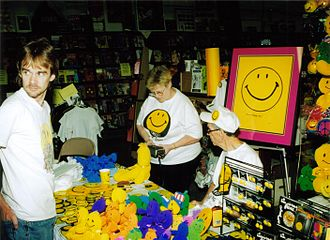 Harvey Ball - Ball (seated) at a public signing, 07/18/1998
