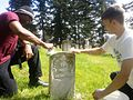 Headstone cleaning by soldiers, airmen and students.jpg