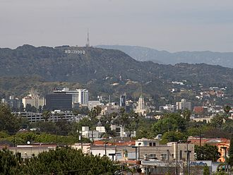 Hollywood Sign - View from West Hollywood, near Santa Monica Boulevard, a few blocks south of Hollywood Boulevard. The historic Hollywood Roosevelt Hotel is visible on the left.