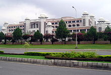 An image of a building taken in day time, official residence of prime minister of Pakistan.
