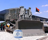 IDF armored D9R bulldozer, with slat armor add-on (in addition to ballistic armor coating and bulletproof glass windows), presented in IDF's Ground Command exhibition for the 60th Independence Day of Israel