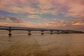 IRRAWADDY FERRY JOURNEY RAILWAY BRIDGE NEAR BAGAN STEAMING TO MANDALAY MYANMA FEB2013.jpg