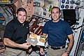 ISS-38 Michael Hopkins and Rick Mastracchio with a Thanksgiving meal.jpg