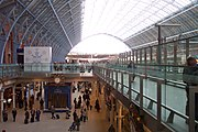 The Arcade at St Pancras railway station, looking north. A Eurostar train can be seen in the platforms to the right.