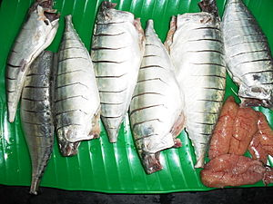 Indian mackerel - Indian mackerel, cleaned and scored and its roe. The heads have been removed.