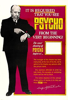"A large image of Hitchcock pointing at his watch. The words at the other side of the poster read, in part, ""It Is Required That You See Psycho From the Very Beginning!"" There is a space for theater staff to advertise the start of the next showing."