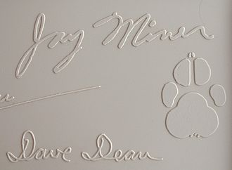 Amiga 1000 - Jay Miner's signature from the top cover of a Commodore Amiga 1000 computer. The paw print is that of Mitchy, Miner's dog.