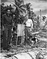 John Donofiro, Milton Wise and Earl Christman with stray dog, Bikini Atoll, summer 1947 (DONALDSON 16).jpeg