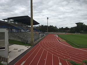 Duchère Stadium - The main stand, the track and the football field.