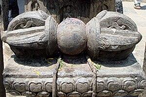 Fleur-de-lis - Large carved stone Dorje (Dervan, Dzierżoń, Đorđe) in Lalitpur (Patan), Nepal.