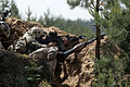 Latvian soldiers take cover in a defensive position during a situational training exercise in Adai, Latvia, June 5, 2013, during exercise Saber Strike 2013 130605-O-ZZ999-004.jpg