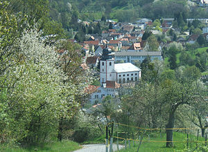 Lautertal, Hesse - Constituent community of Reichenbach with Evangelical church – behind are the Felsenmeerschule and at upper right a dimension stone factory