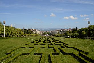 Eduardo VII Park - The central lane of Eduardo VII Park, with Lisbon and the Tagus river in the background