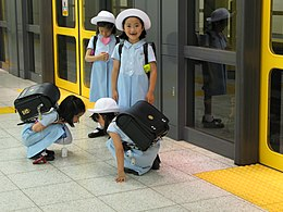 Little japanese girls wearing sailor fuku uniforms.jpg