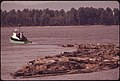 Log Boom with Tug on the Columbia River 05-1973 (4271580803).jpg