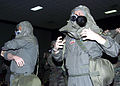 Lt. Col. Douglas Fuller, 2d Operations Group, participates in Chemical Warfare Training, March 1, 2002, at Barksdale Air Force Base, La., by practicing a timed mask donning exercise 020301-F-NN832-003.jpg
