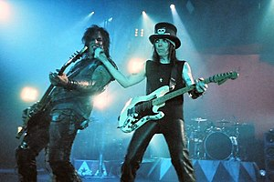 Mötley Crüe - Nikki Sixx and Mick Mars performing onstage with Mötley Crüe, on June 14, 2005 in Glasgow, Scotland