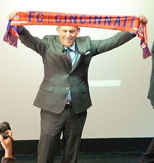 Expansion of Major League Soccer - Garber holds up an FC Cincinnati scarf during his 2016 visit to Cincinnati.