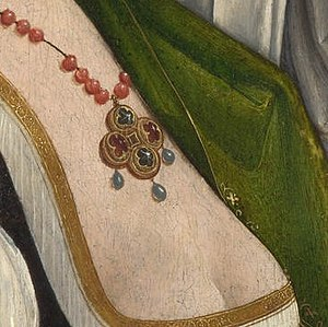 The Magdalen Weeping - Crop showing the pendant of glass beads strung on cord culminating in point-cut diamonds and rubies. Although the work is ostentatiously pious, its sensual daring, seen here in the lace opening of the underdress, indicates the new freedom  available to some well-patronised artists of the early 16th century