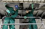 Maintainers clean before painting, inspecting 160104-F-EN010-135.jpg