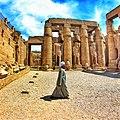 Man walking in Karnak temple.jpg