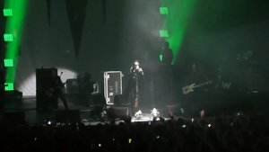 Marilyn Manson performing in 2017. From left to right: Paul Wiley, Tyler Bates, Manson, Daniel Fox and Twiggy Ramirez (Gil Sharone obscured at the drums)