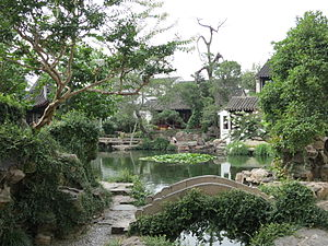 Master of the Nets Garden - View of the Rosy Cloud Pool with Quitetude Bridge in the foreground, Western Garden