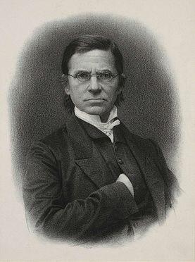 Lithographie de Émile Littré vu de mi-poitrine en noir et blanc. Il a le visage sévère et mets sa main dans sa veste au niveau du cœur.