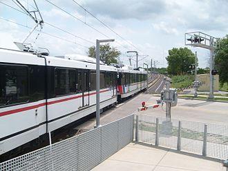 Metro Transit (St. Louis) - MetroLink train departing from the Sunnen station.