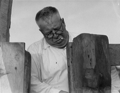 Henry Lotz in May 1937 closing the barn gate at the Midway City Dairy Association, a cooperative in Midway City, California, United States. The Association's 1936 U.S. Resettlement Administration loan was the first to a self-help cooperative and lead the way to other cooperatives applying for loans from the Resettlement Administration.