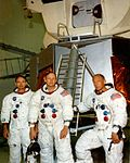 Mike Collins, Neil Armstrong, and Buzz Aldrin (left to right) pose in front of a LM mock-up.jpg