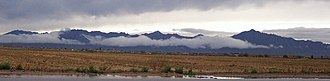 Sierra Estrella - Estrella Mountains from Laveen, January 2004.  Hayes Peak is on the right.