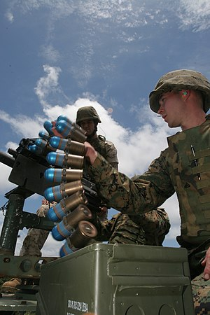 40 mm grenade - Marines load a belt of 40×53mm grenades into the Mk 19 grenade launcher.
