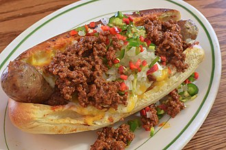 National Chili Dog Day occurs on the fourth Thursday of July. Mmm... chili cheese sausage dog (8075525776).jpg