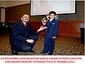 Mohamed Ashik Recieving POGO Amazing Kids Genius Award 2011.jpg