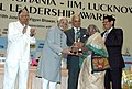 Mohd. Hamid Ansari presenting Lakshmipat Singhania - IIM Lucknow National Leadership Award in the category of Community Service Leader Award to Dr. Tulasi Munda, Social Activist, at a function, in New Delhi on June 10, 2009.jpg
