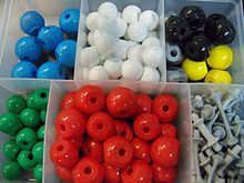 brightly colored plastic balls with holes in them.